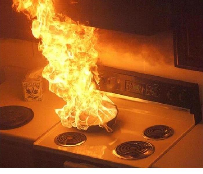 A fire on top of a stove is shown